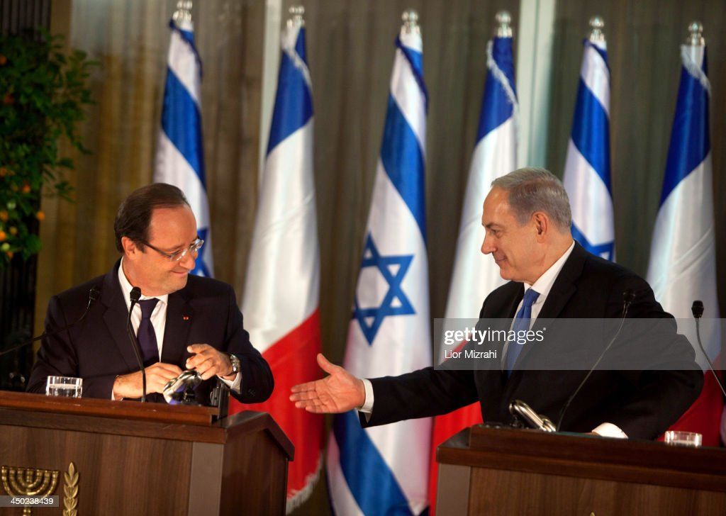 French President Francois Hollande (L) and Israeli Prime Minister <a gi-track='captionPersonalityLinkClicked' href=/galleries/search?phrase=Benjamin+Netanyahu&family=editorial&specificpeople=118594 ng-click='$event.stopPropagation()'>Benjamin Netanyahu</a> during a joint press conference on November 17, 2013 in Jerusalem, Israel. President of France, Francois Hollande is on a three day official visit to Israel and the West Bank.