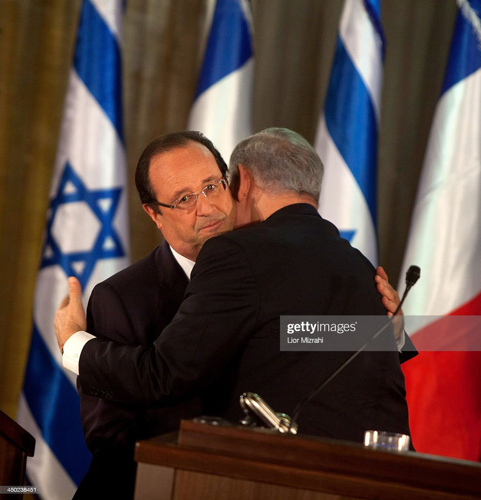French President Francois Hollande (L) and Israeli Prime Minister <a gi-track='captionPersonalityLinkClicked' href=/galleries/search?phrase=Benjamin+Netanyahu&family=editorial&specificpeople=118594 ng-click='$event.stopPropagation()'>Benjamin Netanyahu</a> hugs during a joint press conference on November 17, 2013 in Jerusalem, Israel. President of France, Francois Hollande is on a three day official visit to Israel and the West Bank.