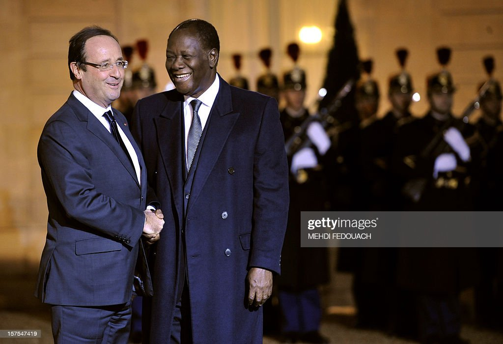 French President Francois Hollande (L) and Ivory Coast President Alassane Ouattara (R) shake hands on December 4, 2012 before their meeting at the Elysee Palace in Paris.