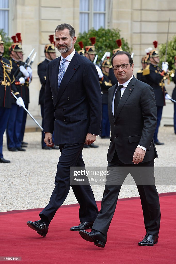 French President Francois Hollande and King Felipe VI of Spain arrive in the courtyard of the Elysee Palace during day 1 of the Spanish Royal...