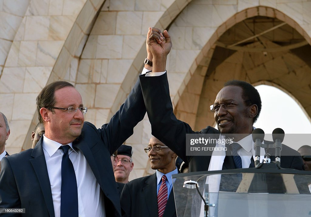 French President Francois Hollande (L) and Malian President Dioncounda Traore (R) wave to the crowd after their speech on February 2, 2013 in Bamako. Hollande called on Africans to take over the fight against extremism as he received a rapturous welcome today in Mali, where a French-led offensive has driven back Islamist rebels from the north.