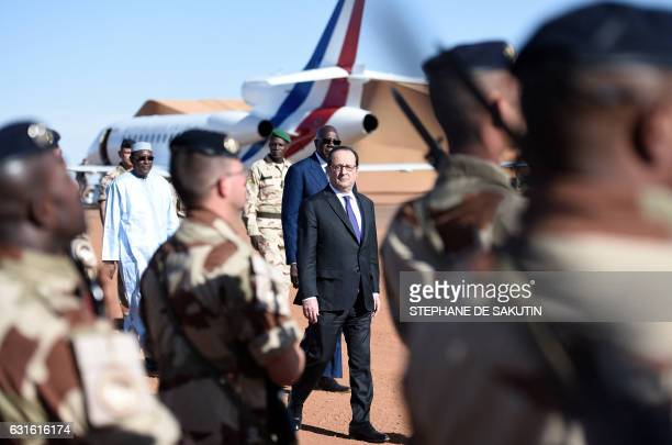 French President Francois Hollande and Malian Prime Minister Modibo Keita visit troops of France's Barkhane counterterrorism operation in Africa's...