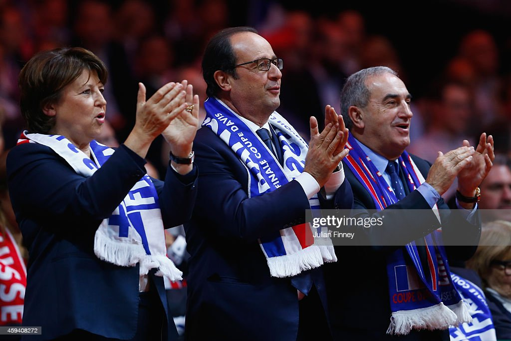 French president, Francois Hollande and <a gi-track='captionPersonalityLinkClicked' href=/galleries/search?phrase=Martine+Aubry&family=editorial&specificpeople=590991 ng-click='$event.stopPropagation()'>Martine Aubry</a> watch play during day two of the Davis Cup Tennis Final between France and Switzerland at the Stade Pierre Mauroy on November 22, 2014 in Lille, France.