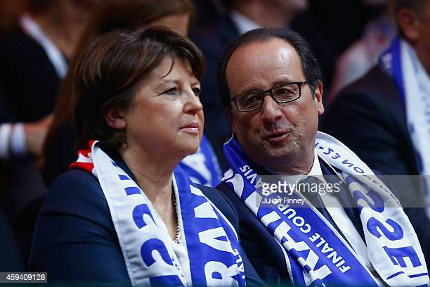 French president Francois Hollande and Martine Aubry watch play during day two of the Davis Cup Tennis Final between France and Switzerland at the...