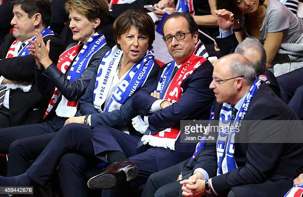 French President Francois Hollande and Mayor of Lille Martine Aubry attend the doubles during day two of the Davis Cup tennis final between France...