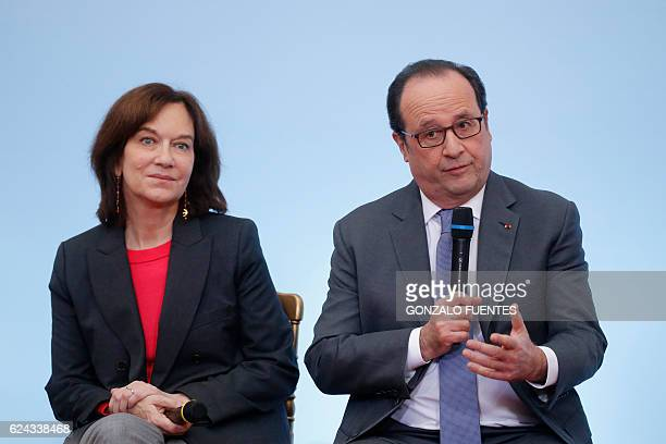 French President Francois Hollande and Minister for the Family Children and Women's Rights Laurence Rossignol attend a ceremony to mark the...