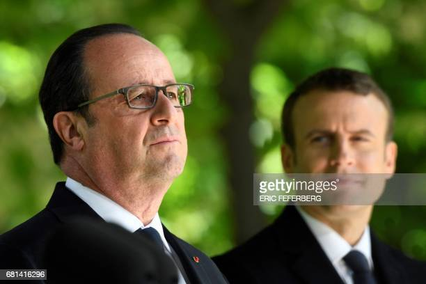 TOPSHOT French President Francois Hollande and newly elected president Emmanuel Macron attend a ceremony to mark the anniversary of the abolition of...