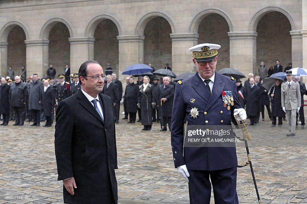 French President Francois Hollande and outgoing French chief of staff admiral Edouard Guillaud attend a ceremony in honor of Guillaud at the Hotel...