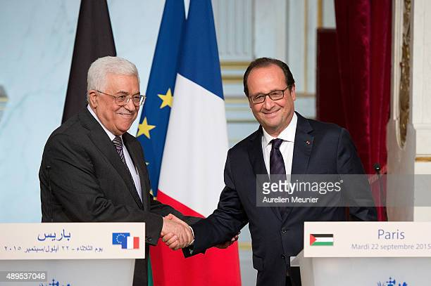 French President Francois Hollande and Palestinian President Mahmoud Abbas shake hands after their joint press conference following a meeting at...