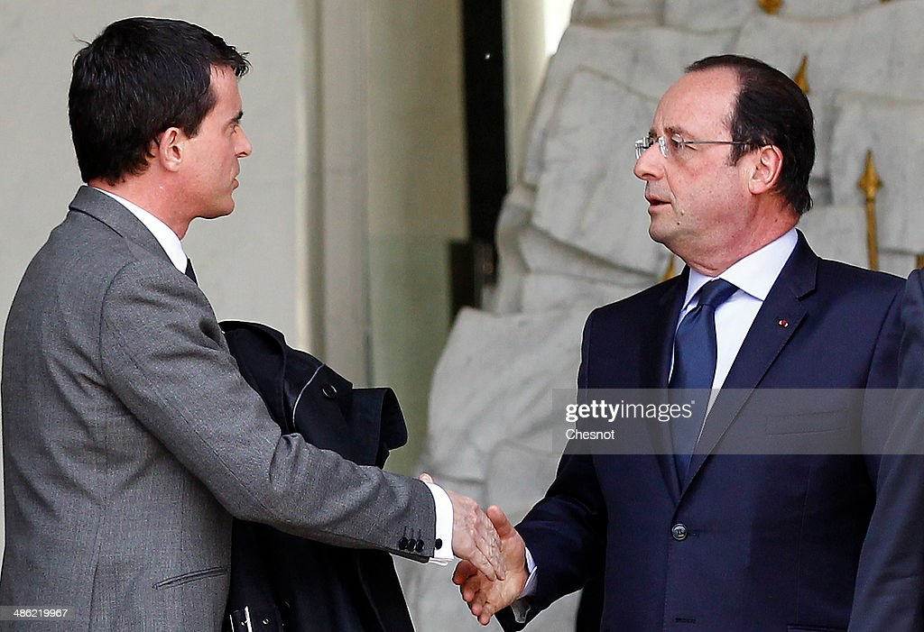 French President, Francois Hollande and Prime minister, Manuel Valls leave after a cabinet meeting at the Elysee Palace on April 23, 2014 in Paris, France. It is the fourth weekly cabinet meeting of France's newly appointed government of Prime Minister Manuel Valls.