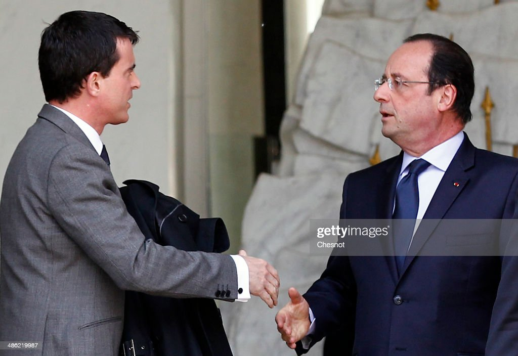 French President, Francois Hollande and Prime minister, <a gi-track='captionPersonalityLinkClicked' href=/galleries/search?phrase=Manuel+Valls&family=editorial&specificpeople=2178864 ng-click='$event.stopPropagation()'>Manuel Valls</a> leave after a cabinet meeting at the Elysee Palace on April 23, 2014 in Paris, France. It is the fourth weekly cabinet meeting of France's newly appointed government of Prime Minister <a gi-track='captionPersonalityLinkClicked' href=/galleries/search?phrase=Manuel+Valls&family=editorial&specificpeople=2178864 ng-click='$event.stopPropagation()'>Manuel Valls</a>.
