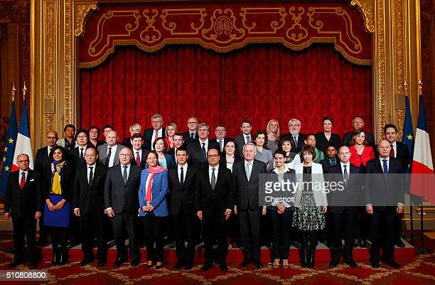 French President Francois Hollande and Prime minister Manuel Valls pose with members of the government for a family picture at the Elysee...