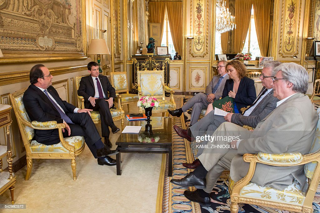 French President Francois Hollande (L) and Prime Minister Manuel Valls (2nd L) meet with French communiste party members (from 4th R) Michel Billout, Anne Sabourin, Pierre Laurent and Patrick Le Hyaric at the Elysee Palace in Paris on June 25, 2016. Europe's press was awash with gloom and doom over Brexit on June 25, warning that it was a boon for nationalists while urging EU leaders to meet the challenge of their 'rendezvous with history'. / AFP / POOL / Kamil Zihnioglu