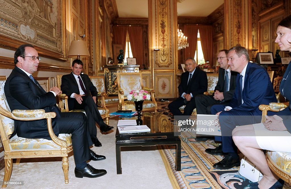 French President Francois Hollande (L) and Prime Minister Manuel Valls (2nd L) meet with French political party Debout la France (DLF) president Nicolas Dupont-Aignan (2nd R) arrives with DLF members Anne Boissel (R), Olivier Clodong (2nd L) and Victor Berenguel (L) at the Elysee Palace in Paris on June 25, 2016. Europe's press was awash with gloom and doom over Brexit on June 25, warning that it was a boon for nationalists while urging EU leaders to meet the challenge of their 'rendezvous with history'. NAEGELEN