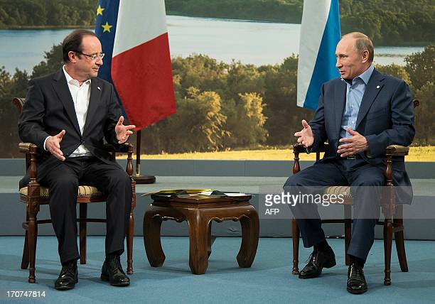 French President Francois Hollande and Russian President Vladimir Putin hold a bilateral meeting at the G8 Summit in Lough Erne Northern Ireland on...