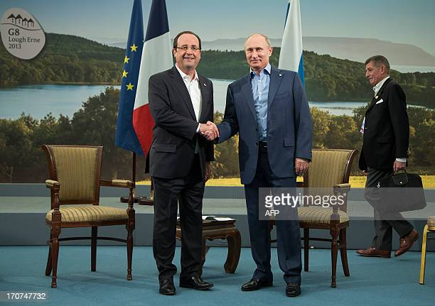 French President Francois Hollande and Russian President Vladimir Putin prepare to hold a bilateral meeting at the G8 Summit in Lough Erne Northern...