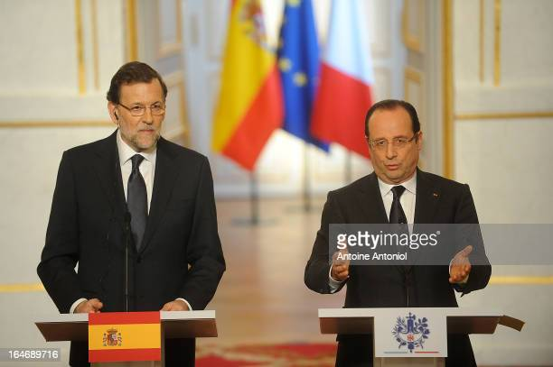 French President Francois Hollande and Spanish Prime Minister Mariano Rajoy speak during a joint press conference at Elysee Palace on March 26 2013...