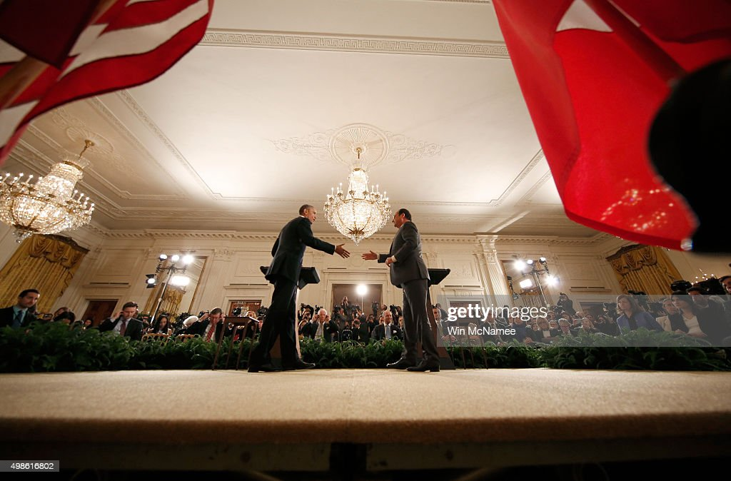 French President Francois Hollande and US President Barack Obama shake hands following a joint press conference in the East Room of the White House...