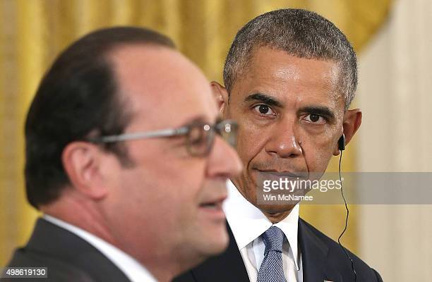 French President Francois Hollande and US President Barack Obama conduct a joint news conference in the East Room of the White House November 24 2015...