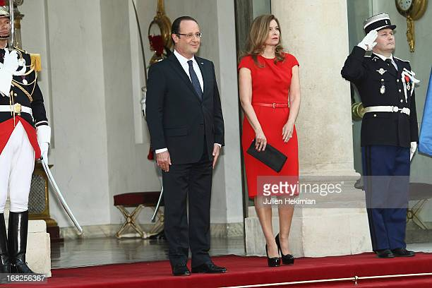 French President Francois Hollande and Valerie Trierweiler pose as they arrive to attend a state dinner at Palace Elysee on May 7 2013 in Paris France