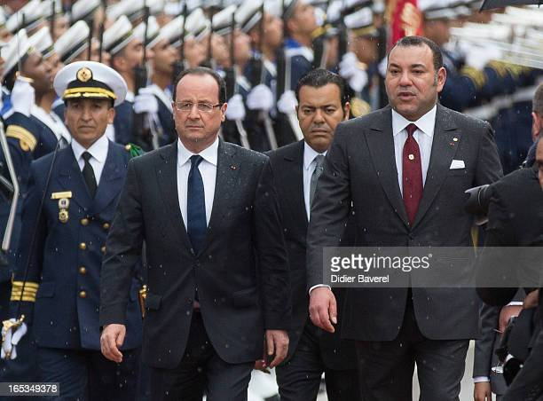 French President Francois Hollande arrives at Casablanca with Prince Moulay Rachid and Morocco's King Mohammed VI on April 3 2013 in Casablanca...