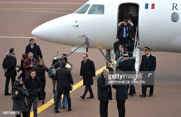 French President Francois Hollande arrives at the SaintPierre airport in the French northern Atlantic island of SaintPierreetMiquelon on December 23...