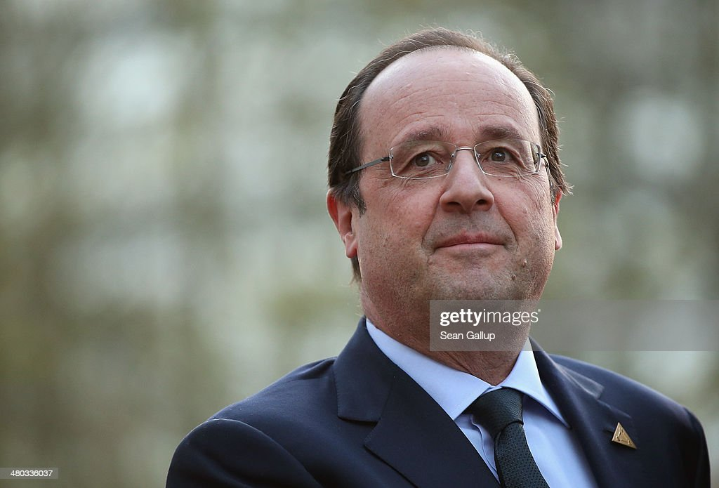 French President Francois Hollande arrives for a meeting of G7 leaders on March 24 2014 in The Hague Netherlands The G7 leaders are meeting to dicuss...