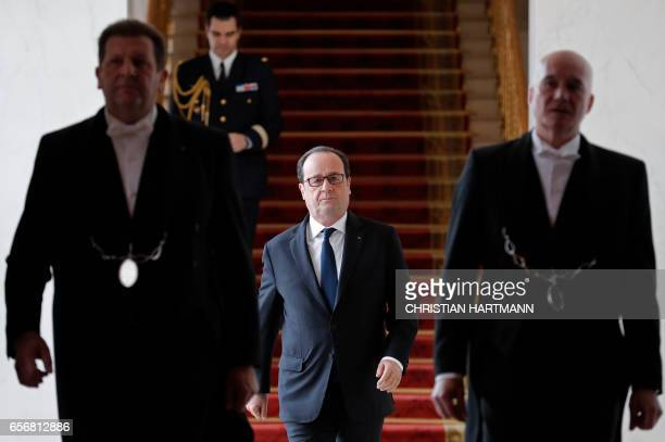 French President Francois Hollande arrives for an event on state reform and simplification at the Elysee Palace in Paris on March 23 2017 / AFP PHOTO...