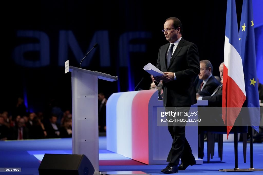French President Francois Hollande arrives to deliver a speech during the opening ceremony of the 95th French Mayors congress, on November 20, 2012 in Paris. AFP PHOTO KENZO TRIBOUILLARD