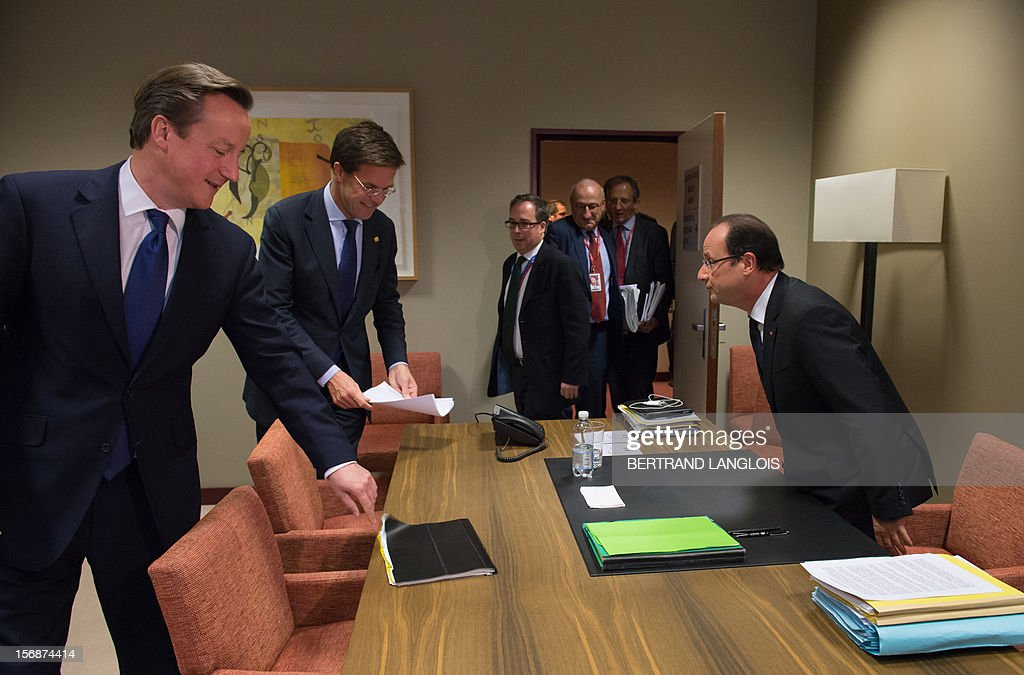 French President Francois Hollande (R) arrives with British Prime Minister David Cameron (L) and Dutch Prime Minister Mark Rutte arrive to take part in a meeting at the EU Headquarters, on November 23, 2012 in Brussels, as part of a two-day European Union leaders summit called to agree a hotly-contested trillion-euro budget through 2020. European leaders voiced pessimism on reaching a deal on a trillion-euro EU bdget, as gruelling talks pushed into a second day with little prospect of bridging bitter divisions. POOL