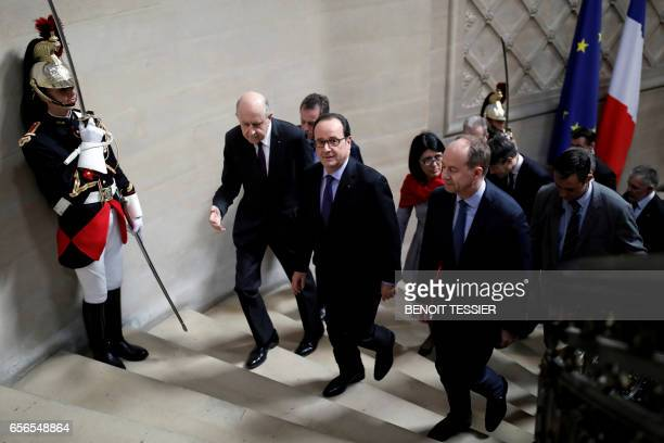 French President Francois Hollande arrives with French Justice minister JeanJacques Urvoas and Council of State Vicepresident JeanMarc Sauve for a...