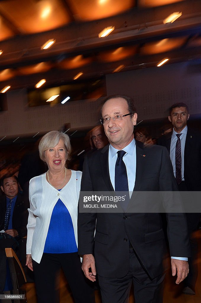 French President Francois Hollande arrives with the director of the Pasteur Institute Alice Dautry (L) to deliver a speech after the inauguration of the new department of the Emerging diseases on November 14, 2012 in Paris.