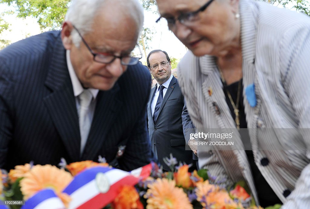 French President Francois Hollande (C) attends a ceremony in Tulle, central France, on June 9, 2013, to commemorate the Nazi massacre of Tulle in 1944.