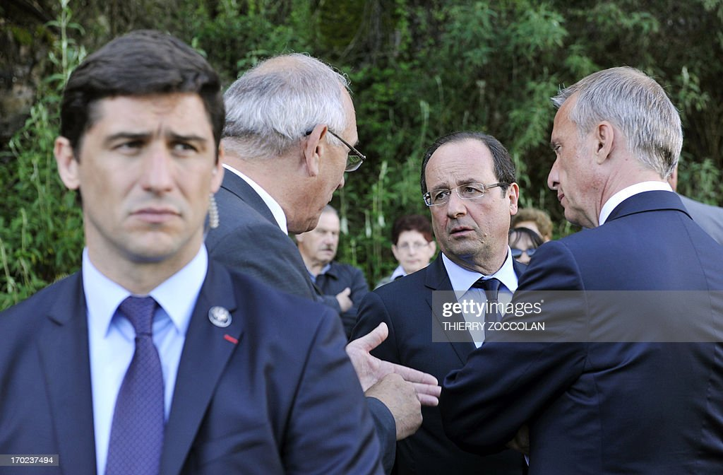French President Francois Hollande (2nd R) attends a ceremony in Tulle, central France, on June 9, 2013, to commemorate the Nazi massacre of Tulle in 1944.
