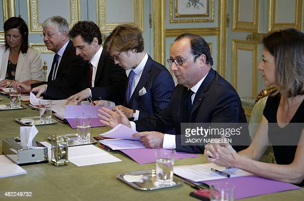 French President Francois Hollande attends a meeting to apply the European Commission's plan to boost growth at the Elysee Palace in Paris on July 29...