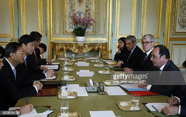 French President Francois Hollande attends a meeting with Chinese State Councillor Yang Jiechi at the Elysee Palace in Paris on April 13 2016 / AFP /...