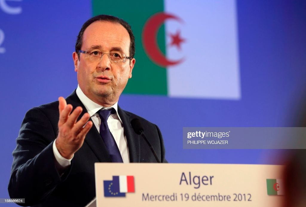 French President Francois Hollande attends a press conference in Algiers on December 19, 2012 as part of the first day of his state visit to Algeria. President Francois Hollande travels to Algeria on Wednesday to try to heal wounds left by a bloody war of independence half a century ago and to seek greater access to the former colony's oil wealth in an attempt to lift France's own flagging economy. AFP PHOTO POOL PHILIPPE WOJAZER
