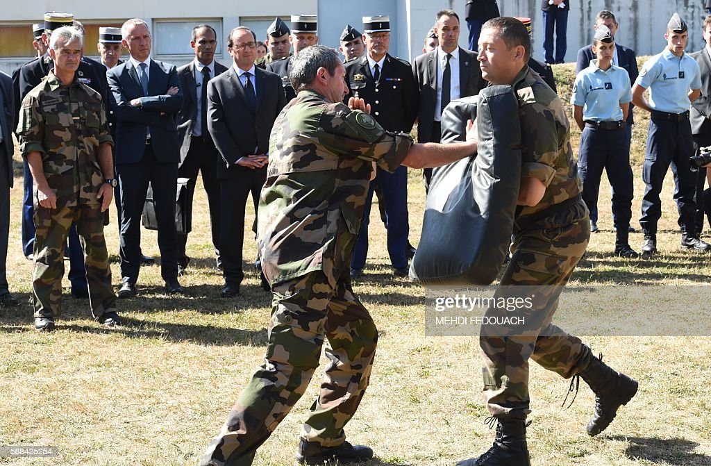 French President Francois Hollande attends a soldiers training during a visit at the French Gendarmerie school in Tulle central France on August 11...