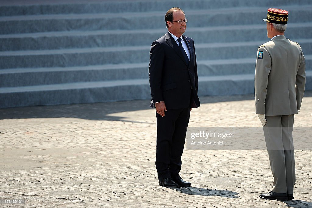 French President Francois Hollande attends the Bastille Day parade on the Champs Elysees on July 14, 2013 in Paris, France. The annual military ceremony is the largest in Europe remembering the 'Fete de la Federation' for 1790.