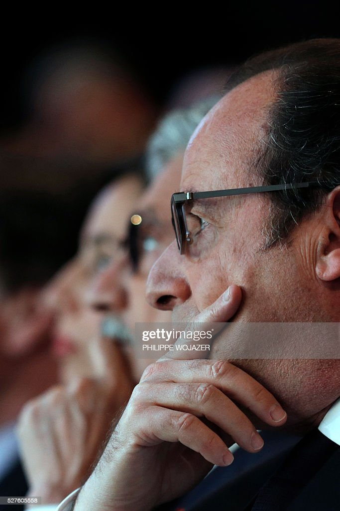 French President Francois Hollande attends the conference 'Left wing and Power' at the Jean-Jaures Foundation in Paris, on May 3, 2016. Hollande defended on May 3 his government's labour reforms law as a 'text of progress', few hours before its examination by the parliament, adding he sees it as a 'dynamic and fair compromise'. / AFP / POOL / PHILIPPE
