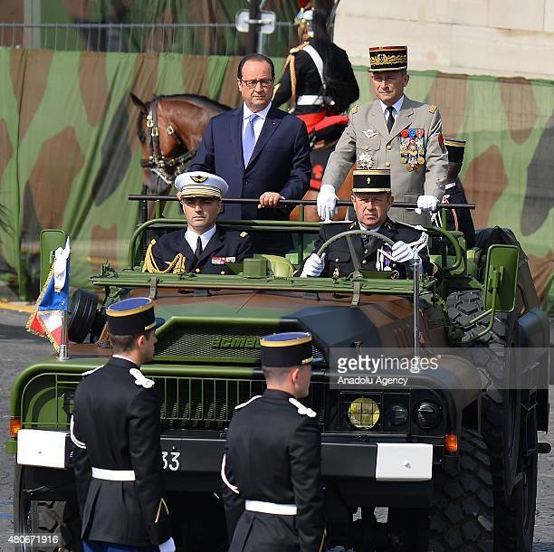 French President Francois Hollande attends the military parade in the Republic Day on the Champs Elysees in Paris France on July 14 2015