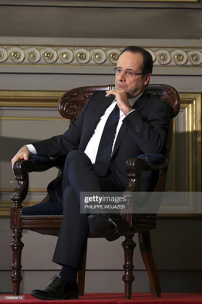 French President Francois Hollande attends the traditional New Year ceremony which reopens France's highest court (Cour de Cassation) in Paris, on January 18, 2013. AFP PHOTO / POOL / PHILIPPE WOJAZER