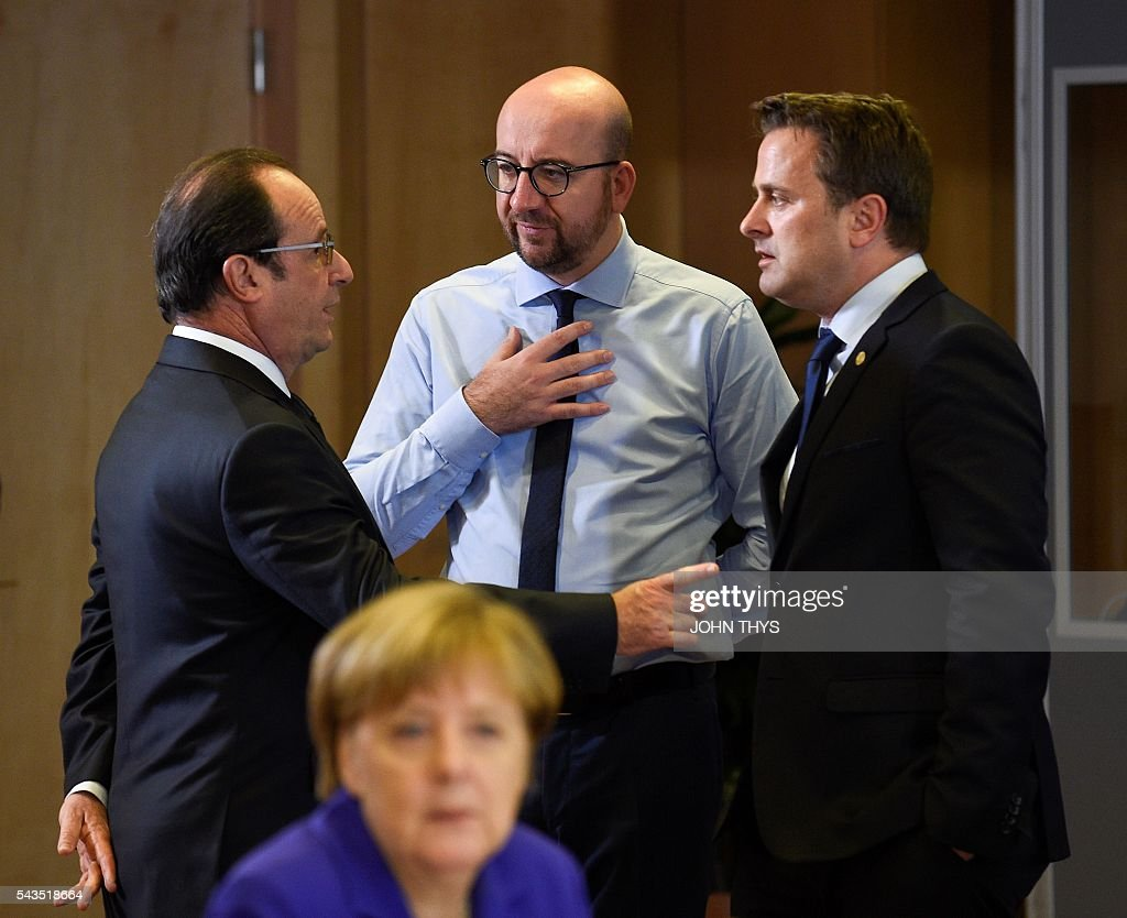 French President Francois Hollande, Belgian Prime minister Charles Michel and Luxembourg Prime minister Xavier Bettel talk as German chancellor Angela Merkel (Front) looks on during the second day of an EU - Summit at the EU headquarters in Brussels on June 29, 2016. European Union leaders will on June 29, 2016 assess the damage from Britain's decision to leave the bloc and try to prevent further disintegration, as they meet for the first time without a British representative. / AFP / JOHN