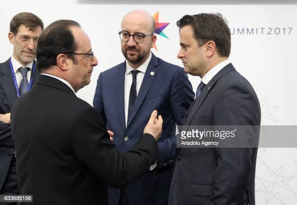 French President Francois Hollande Belgian Prime Minister Charles Michel and Prime Minister of Luxembourg Xavier Bettel chat during an unofficial...