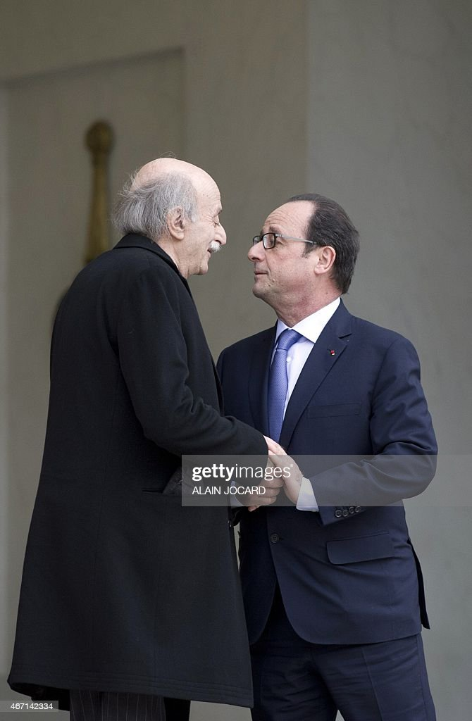 French President Francois Hollande (R) bids farewell to Lebanese Druze leader and Lebanese Progressive Socialist Party (PSP) chairman <a gi-track='captionPersonalityLinkClicked' href=/galleries/search?phrase=Walid+Jumblatt&family=editorial&specificpeople=228719 ng-click='$event.stopPropagation()'>Walid Jumblatt</a> after a meeting at the Elysee palace, on March 21, 2015, in Paris.