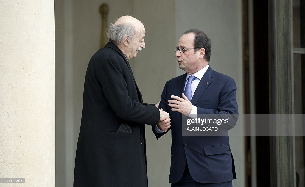 French President Francois Hollande (R) bids farewell to Lebanese Druze leader and Lebanese Progressive Socialist Party (PSP) chairman <a gi-track='captionPersonalityLinkClicked' href=/galleries/search?phrase=Walid+Jumblatt&family=editorial&specificpeople=228719 ng-click='$event.stopPropagation()'>Walid Jumblatt</a> after a meeting at the Elysee palace, on March 21, 2015, in Paris. AFP PHOTO / ALAIN JOCARD