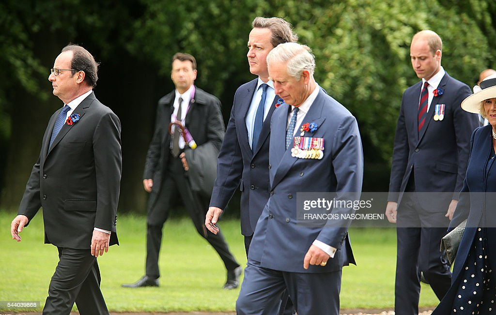 French President Francois Hollande, Britain's Prime Minister David Cameron, Britain's Prince Charles, Britain's Prince William and Britain's Princess Camilla march towards the Thiepval Memorial to attend a ceremony marking the 100th anniversary of the World War I battle at the River Somme. Under grey skies, unlike the clear sunny day that saw the biggest slaughter in British military history a century ago, the commemoration kicked off at the deep Lochnagar crater, created by the blast of mines placed under German positions two minutes before the attack began at 7:30 am on July 1, 1916. / AFP / FRANCOIS