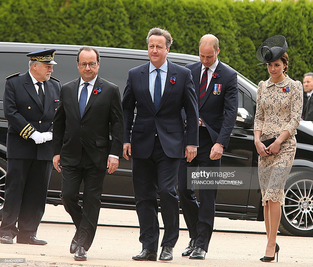French President Francois Hollande, Britain's Prime Minister David Cameron, Britain's Prince William and his wife Britain's Princess Catherine march towards the Thiepval Memorial to attend a ceremony marking the 100th anniversary of the World War I battle at the River Somme. Under grey skies, unlike the clear sunny day that saw the biggest slaughter in British military history a century ago, the commemoration kicked off at the deep Lochnagar crater, created by the blast of mines placed under German positions two minutes before the attack began at 7:30 am on July 1, 1916. / AFP / FRANCOIS