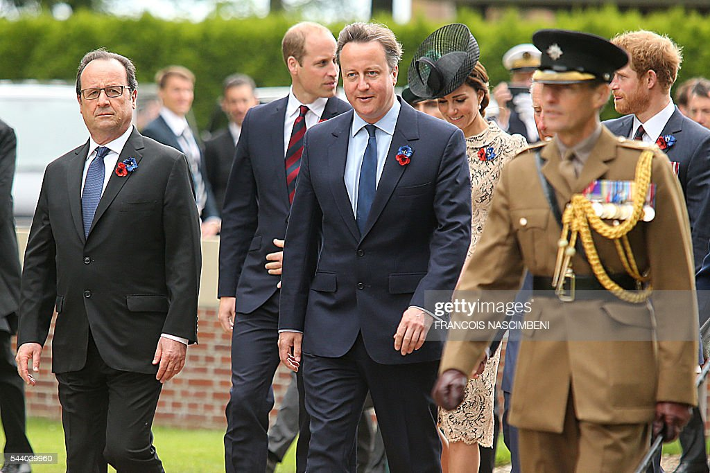 French President Francois Hollande, Britain's Prince William, Britain's Prime Minister David Cameron, Britain's Princess Catherine and Britain's Prince Harry march towards the Thiepval Memorial to attend a ceremony marking the 100th anniversary of the World War I battle at the River Somme. Under grey skies, unlike the clear sunny day that saw the biggest slaughter in British military history a century ago, the commemoration kicked off at the deep Lochnagar crater, created by the blast of mines placed under German positions two minutes before the attack began at 7:30 am on July 1, 1916. / AFP / FRANCOIS