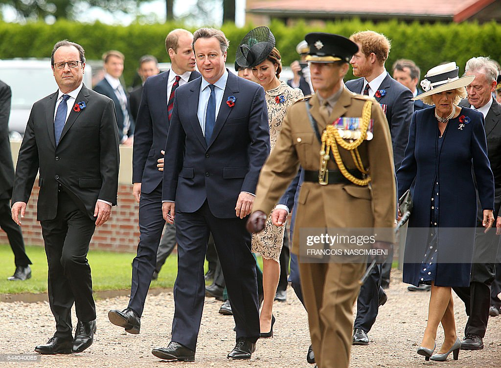 French President Francois Hollande, Britain's Prince William, Britain's Prime Minister David Cameron, Britain's Princess Catherine, Britain's Prince Harry and Britain's Princess Camilla march towards the Thiepval Memorial to attend a ceremony marking the 100th anniversary of the World War I battle at the River Somme. Under grey skies, unlike the clear sunny day that saw the biggest slaughter in British military history a century ago, the commemoration kicked off at the deep Lochnagar crater, created by the blast of mines placed under German positions two minutes before the attack began at 7:30 am on July 1, 1916. / AFP / FRANCOIS